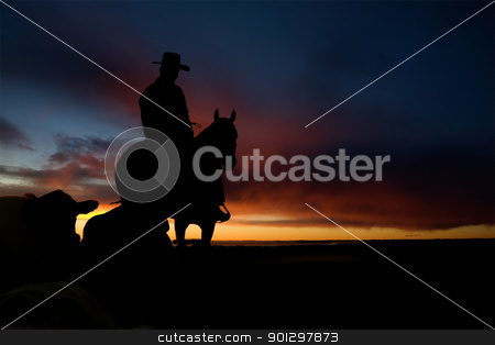 Cowboy Silhouette stock photo, A cowboy on a hill against a sunset by Tyler Olson