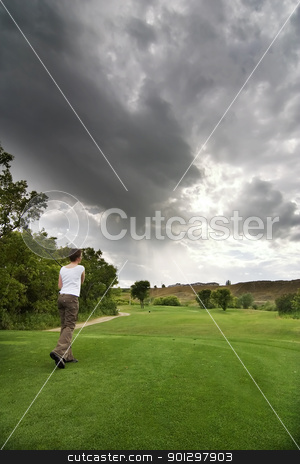 Teeing Off stock photo, A golfer at the tee by Tyler Olson