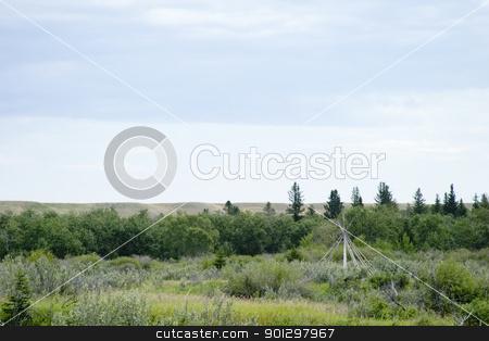 Teepee Frame Landscape stock photo, Teepee frame on the saskatchewan landscape by Tyler Olson