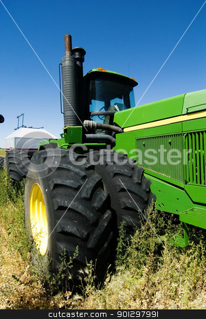 Air Seeder stock photo, A large air seeder system being pulled behind a John Deere Tractor by Tyler Olson