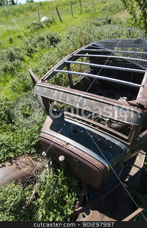 Rusted Prairie Car stock photo, An old rusted out car on the prairie landscape by Tyler Olson