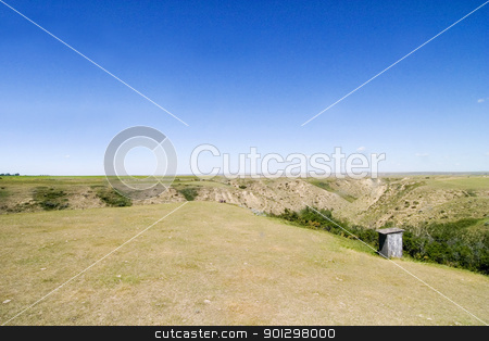 Prairie Landscape stock photo, Outhouse on the prairie landscape by Tyler Olson