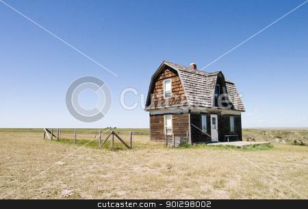 Prairie Homestead stock photo, A prairie homestead house on a skyless day. by Tyler Olson