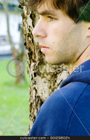 Thinking stock photo, A male standing by a tree thinking by Tyler Olson