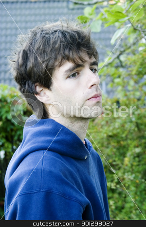 Sceptic Youth stock photo, A young sceptic youth in a blue bunny hug by Tyler Olson