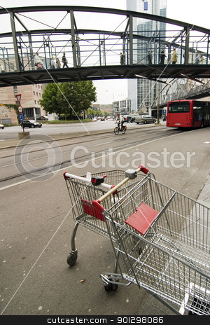 Downtown Abstract stock photo, Downtown abstract busy image with shopping cart in foreground by Tyler Olson