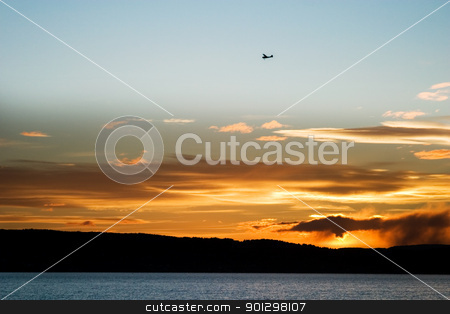 Oslo Fjord stock photo, An airplane flying over the Oslo Fjord during sunset. by Tyler Olson
