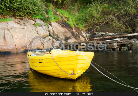 Yellow Boat stock photo, A yellow plastic boat on the coast of norway. by Tyler Olson