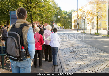 Downtown Oslo stock photo, A group of people waiting for the bus downtown Oslo, Norway. (year 2005) by Tyler Olson