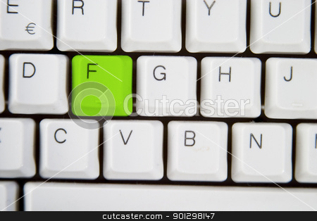 Computer Keyboard Letter F stock photo, Isolated letter F on from a computer desktop keyboard highlighted in green by Tyler Olson
