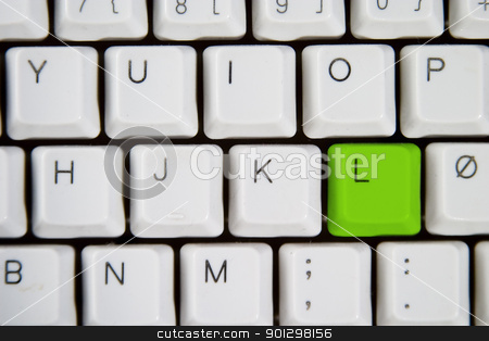 Computer Keyboard Letter L stock photo, Isolated letter L on from a computer desktop keyboard highlighted in green  by Tyler Olson