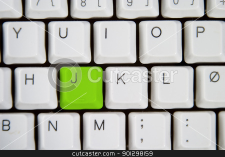 Computer Keyboard Letter J stock photo, Isolated letter J on from a computer desktop keyboard highlighted in green  by Tyler Olson