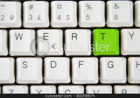 Computer Keyboard Letter T stock photo, Isolated letter T on from a computer desktop keyboard highlighted in green by Tyler Olson