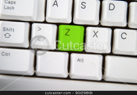 Computer Keyboard Letter Z stock photo, Isolated letter Z on from a computer desktop keyboard highlighted in green. by Tyler Olson