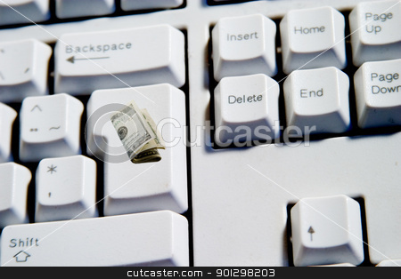 Cash Key stock photo, Computer Keyboard from a desktop computer with the enter key with a 20 dollar bill roll merged into it by Tyler Olson