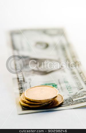 Canadian VS American Dollar stock photo, Canadian Dollar VS the American Dollar with the canadian dollar in focus by Tyler Olson