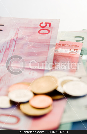 Canadian Bills and Coins stock photo, An assortment of Canadian bills and coins. by Tyler Olson