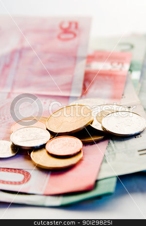Canadian Bills and Coins stock photo, An assortment of Canadian bills and coins with the focus on the coins. by Tyler Olson