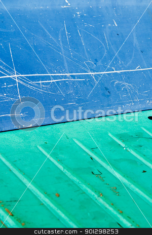 Plastic Abstract stock photo, A blue and green plastic subway seat background texture image. by Tyler Olson