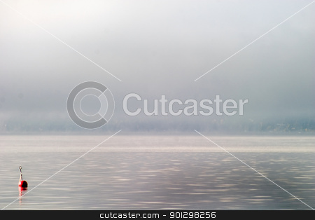 Buoy in the Fog stock photo, Buoy on a foggy ocean by Tyler Olson