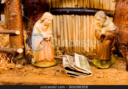 Nativity Scene with Money stock photo, Commercialism vs Christmas Mary Joseph Christ and Money by Tyler Olson