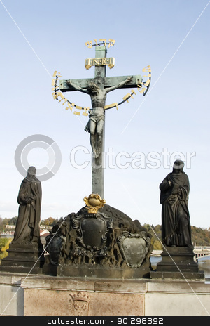 Suffering Christ stock photo, Statue on the Charles Bridge of Christ on the cross, Prague, Czech Republic by Tyler Olson