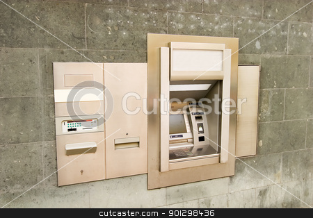 Bank Machine stock photo, A bank machine on a stone wall. by Tyler Olson