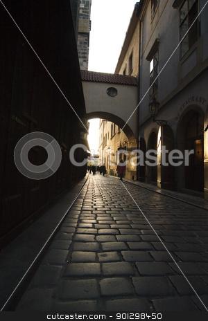 Small Dark Street stock photo, A small moody dark street in Prague, Czech Republic. by Tyler Olson