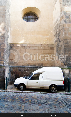 Tight Parallel Park stock photo, A humorous image of a cargo truck parked between two large buttresses at the St. Giles Church, Prague, Czech Republic. by Tyler Olson