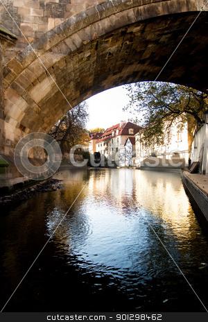 Stone Bridge Detail stock photo, A large stone bridge detail along a river going through the old town area of Prague, Czech Republic. by Tyler Olson