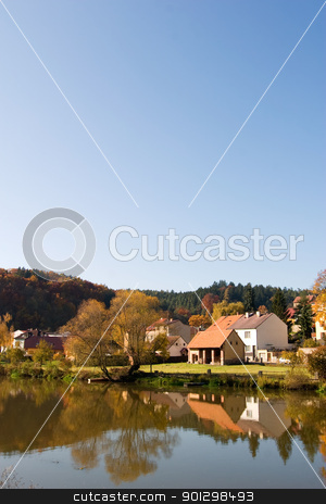 Fall Reflection stock photo, A picturesque fall reflection of a quaint european village by Tyler Olson
