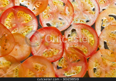 Tomato Slice Background stock photo, Tomato slice background texture image by Tyler Olson