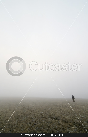 Prairie Fog Walk stock photo, Walking in prairie fog in a meadow by Tyler Olson