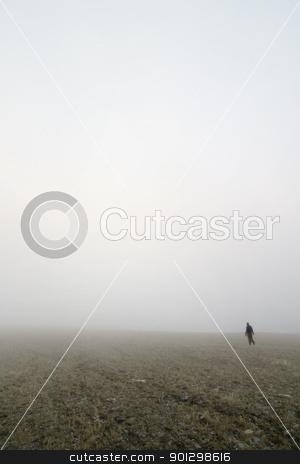 Prairie Fog Walk stock photo, Walking in prairie fog in a meadow by Tyler Olson