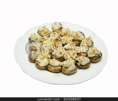 Stuffed Mushrooms stock photo, A plate of stuffed mushrooms isolated on white with clipping path. by Tyler Olson