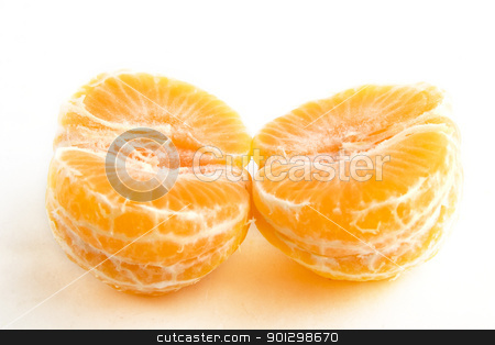 Halved Christmas orange stock photo, A christmas orange in two halves. by Tyler Olson