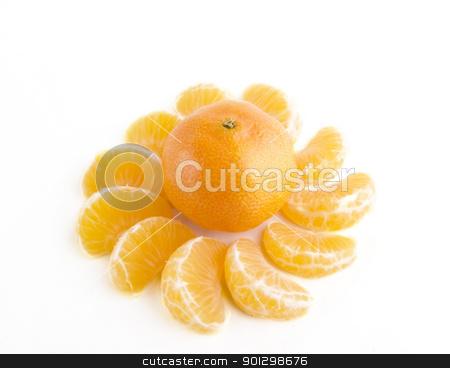 Christmas Orange Design stock photo, Christmas orange with slices making a pattern around it. by Tyler Olson