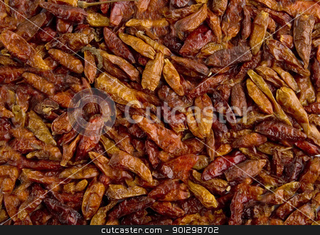 Bulk Hot Chillies Background stock photo, Dried bulk holt chillies background by Tyler Olson