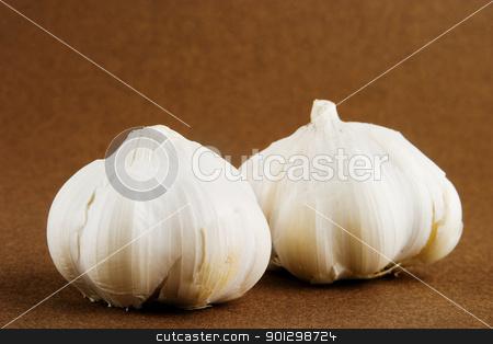 Garlic stock photo, Garlic (Allium sativum) cloves on a dark background by Tyler Olson