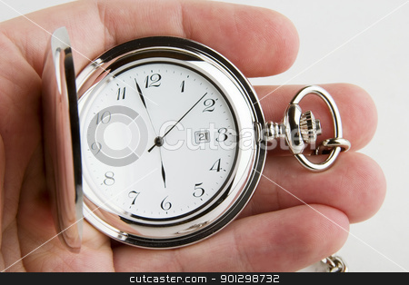 Pocket Watch stock photo, A male hand holding a fancy pocket watch by Tyler Olson