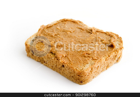 Chunky Peanut Butter Slice stock photo, Chunky peanut butter on a slice of homemade bread. by Tyler Olson