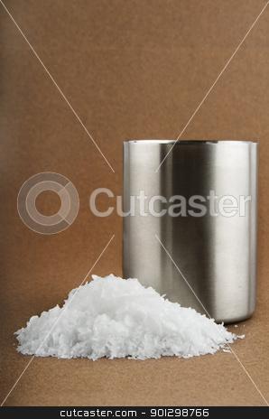 Sea Salt stock photo, Bulk raw, unground sea salt on a textured brown background by Tyler Olson