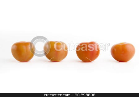 Four Tomatoes stock photo, Four ripe red tomatoes on a white background by Tyler Olson
