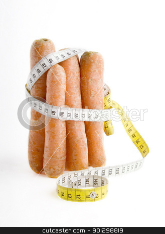 Healthy Diet stock photo, A group of carrots wrapped in a tape meastuer. by Tyler Olson