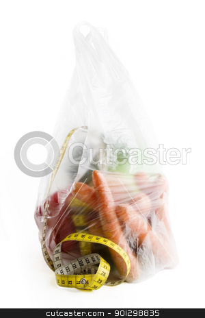 Healthy Choice stock photo, Healthy vegetables in a clear plastic grocery bag on a white background with a tape measure in the foreground by Tyler Olson