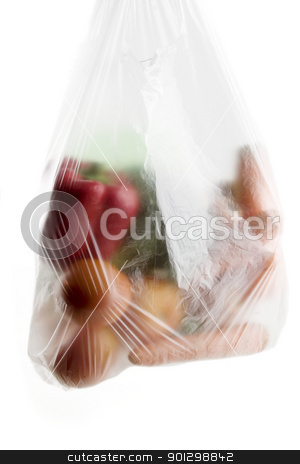 Vegetable Groceries stock photo, A clear plastic grocery bag filled with vegetables, a healthy choice by Tyler Olson