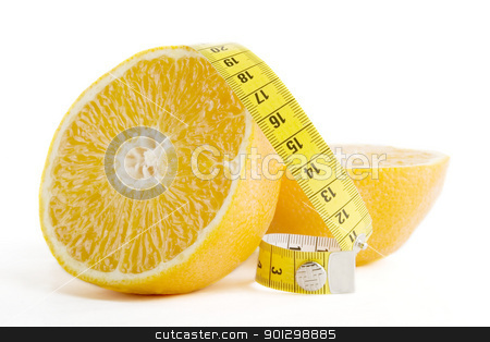 Orange Health stock photo, A freshly cut orange with a measuring tape. by Tyler Olson