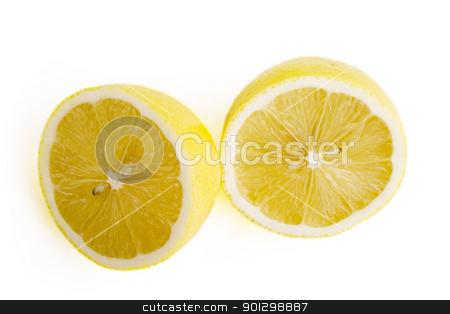 Sliced lemon stock photo, A lemon sliced in half by Tyler Olson