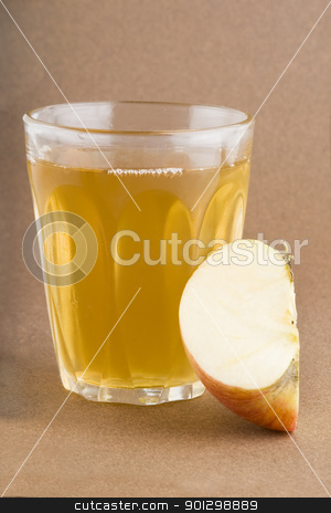 Fresh Apple Juice stock photo, Fresh apple juice on a dark background. by Tyler Olson