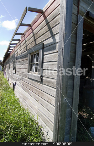 Wooden Barn stock photo, An old barn detail on the prairie by Tyler Olson